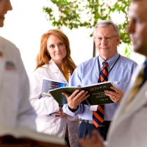 Group of medical students and professor - Click to see full photograph